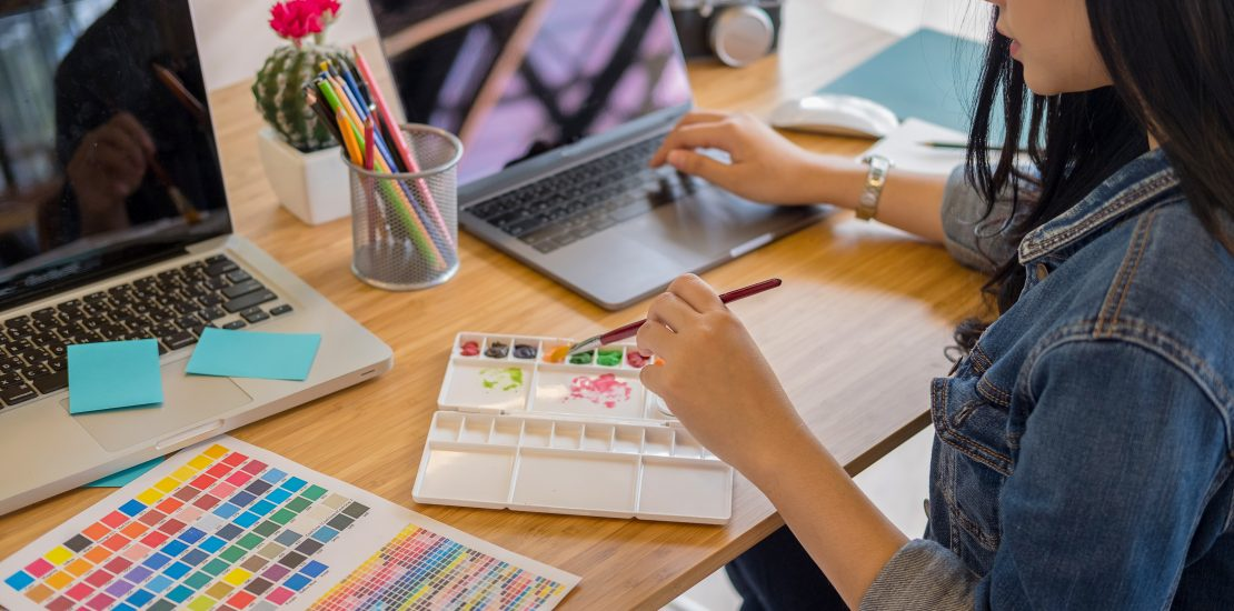 Graphic designers work with computer and mouse pen design products and websites, Graphic designers concept